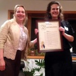 Westchester County Legislator Catherine Parker (left) presents outgoing LWV-LM president Elisabeth Radow with a proclamation in her honor.